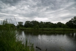 Beautiful storm clouds over the pond on our new land